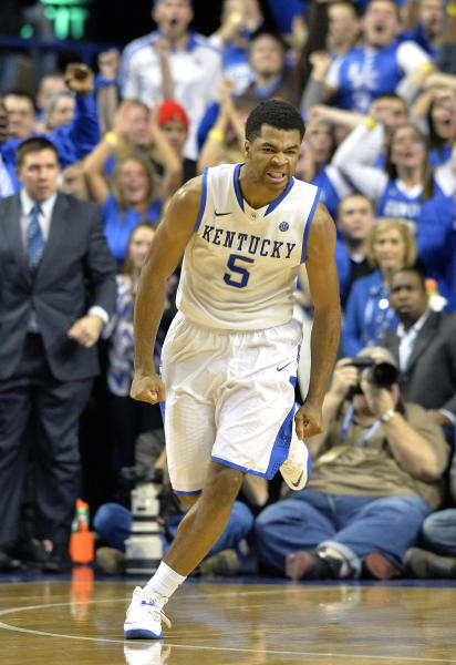 Kentucky's Andrew Harrison reacts after scoring a basket during the second half of an NCAA college basketball game against Louisville, Saturday, Dec. 28, 2013, in Lexington, Ky. Kentucky defeated Louisville 73-66. (AP Photo/Timothy D. Easley)