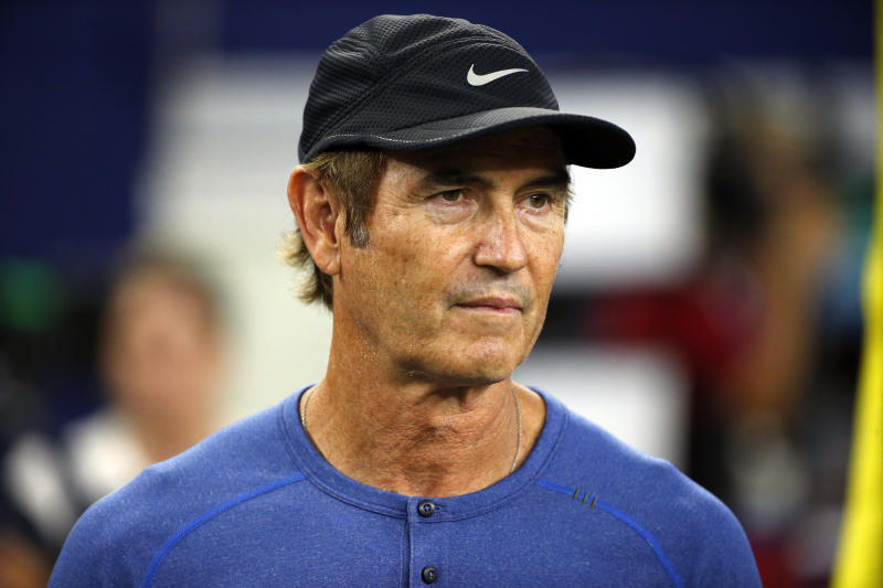Former Baylor head football coach Art Briles watches the Dallas Cowboys and the Chicago Bears warm up before an NFL football game, Sunday, Sept. 25, 2016, in Arlington, Texas. (AP Photo/Ron Jenkins)