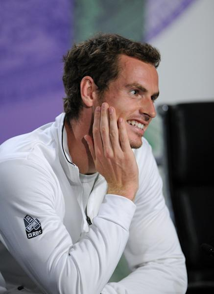 Andy Murray of Britain speaks during a news conference after he won the Men's singles final match against Novak Djokovic of Serbia at the All England Lawn Tennis Championships, Wimbledon, London, Sunday, July 7, 2013. (AP Photo/AELTC, Jon Buckle)