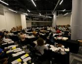Employees of the Fulton County Board of Registration and Elections process ballots in Atlanta