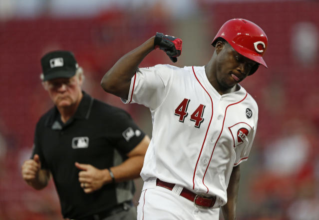 Cincinnati Reds' Aristides Aquino (44) reacts as he rounds third on a solo home run off Los Angeles Angels starting pitcher Jose Suarez during the fourth inning of a baseball game, Tuesday, Aug. 6, 2019, in Cincinnati. (AP Photo/Gary Landers)