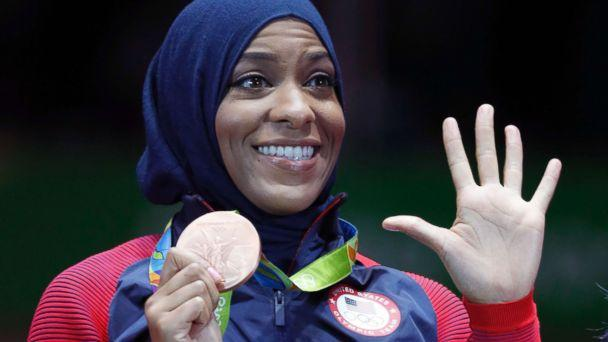 PHOTO: Ibtihaj Muhammad of the U.S. pose with her bronze medals on the podium after the women's team sabre fencing event at the 2016 Summer Olympics, in Rio de Janeiro, Brazil, Aug. 13, 2016. (Vincent Thian/AP)