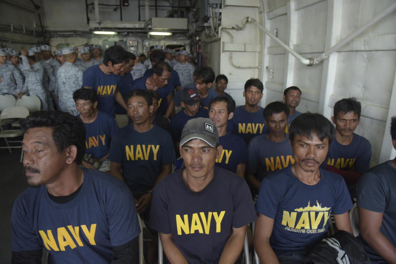 Rescued Filipino fishermen sit inside Philippine Navy ship BRP Ramon Alcuaz as they head back to shore at Occidental Mindoro province, Philippines on Friday June 14, 2019. (AP Photo)