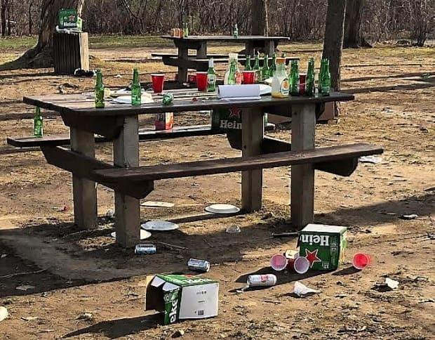 Empty bottles and litter left at Vincent Massey Park on the weekend had Ottawa Mayor Jim Watson calling for early park closures across the city. Instead, staff will focus on closing a few problem parks by 9 p.m. (Ian Black/CBC - image credit)