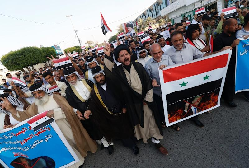 Iraqi protest against military strikes on Syria in the town of Basra on 15 April, 2018 (AFP Photo/HAIDAR MOHAMMED ALI)