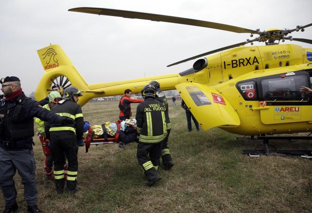<p>A train passenger on a stretcher is carried to a helicopter after a train derailed at the station of in Pioltello Limito, on the outskirts of Milan, Italy, Thursday, Jan. 25, 2018. (Photo: Luca Bruno/AP) </p>