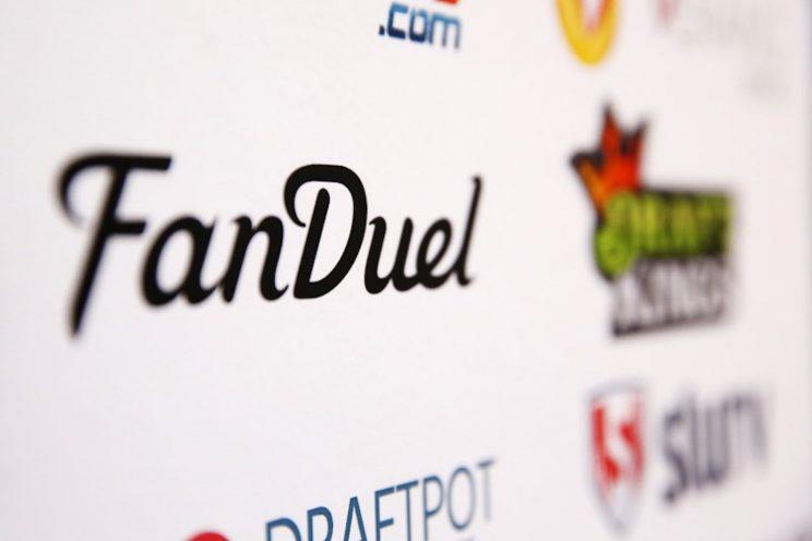 A FanDuel logo is displayed on a board inside of the DFS Players Conference.