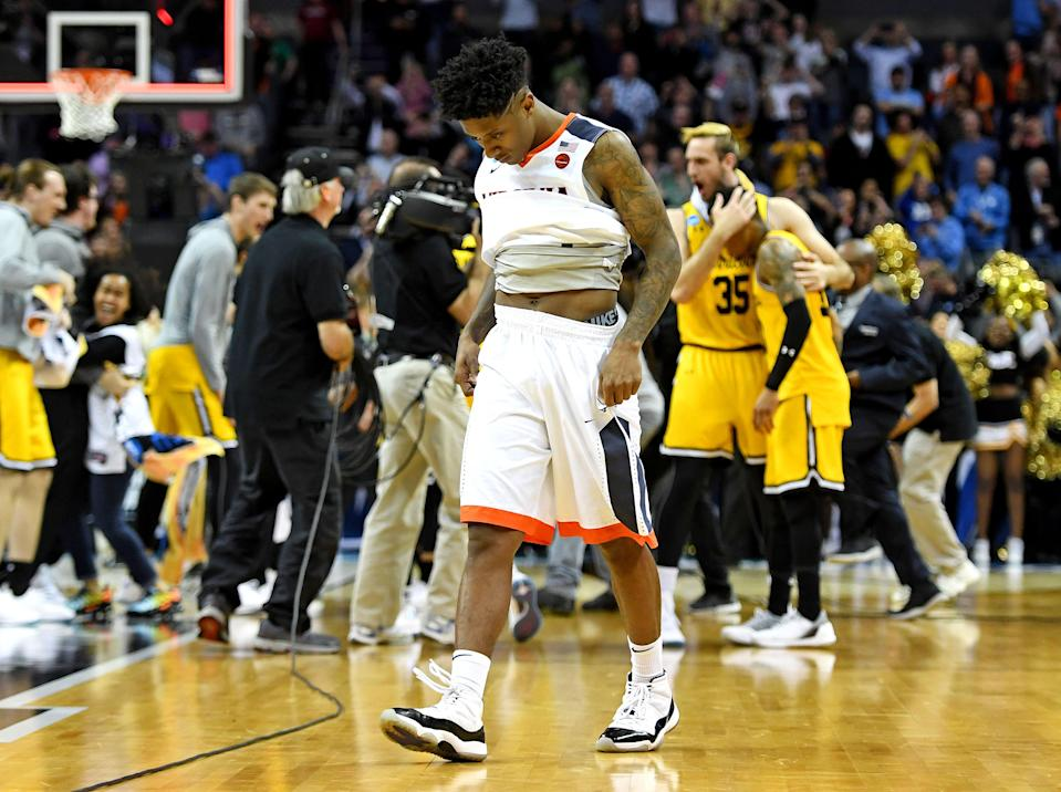 <p>Virginia Cavaliers guard Nigel Johnson (23) reacts after loosing to the UMBC Retrievers in the first round of the 2018 NCAA Tournament at Spectrum Center. Mandatory Credit: Bob Donnan-USA TODAY Sports </p>