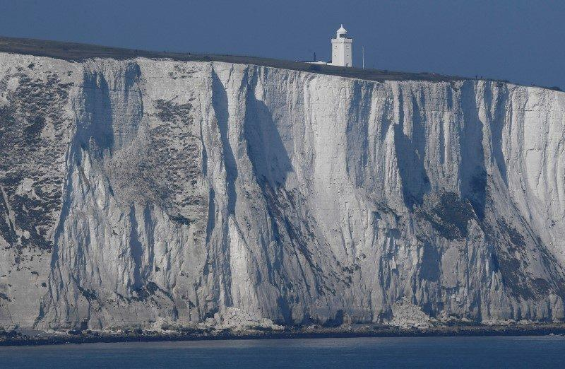 South Foreland lighthouse and the white cliffs of Dover are seen from a cross-channel ferry - Credit: Reuters