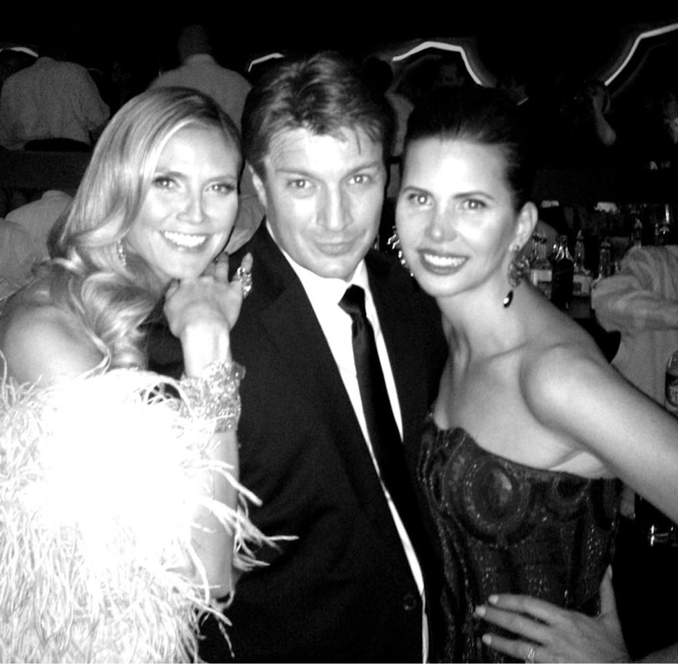 Who is this stranger between me & @heidiklum clue ....@NathanFillion - @desireegruber