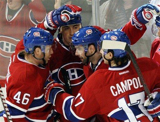 Montreal Canadiens center Louis Leblanc (71) celebrates with teammates after scoring against the Pittsburgh Penguins during the second period of an NHL hockey game Tuesday, Feb. 7, 2012, in Montreal. (AP Photo/The Canadian Press, Ryan Remiorz)