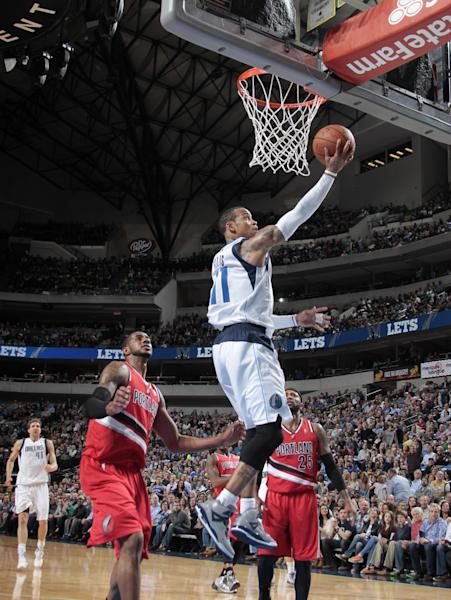 DALLAS, TX - MARCH 7: Monta Ellis #11 of the Dallas Mavericks shoots against LaMarcus Aldridge #12 of the Portland Trail Blazers on March 7, 2014 at the American Airlines Center in Dallas, Texas. (Photo by Danny Bollinger/NBAE via Getty Images)