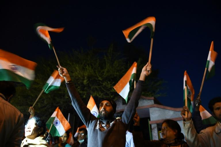 Indians celebrate the execution of four men found guilty of the murder and gang rape of a 23-year-old woman in New Delhi