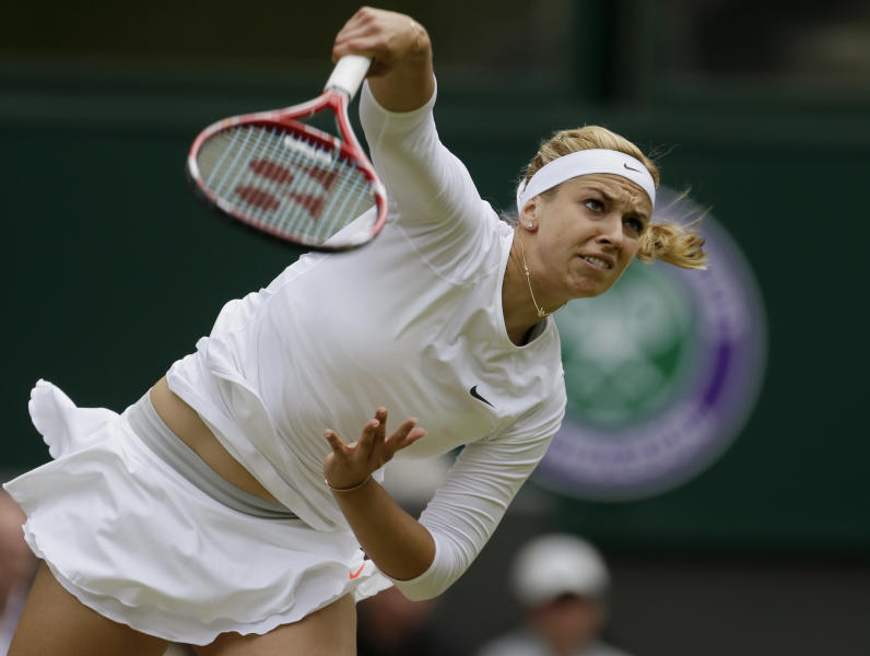 Sabine Lisicki of Germany serves to Serena Williams of the United States in a Women's singles match at the All England Lawn Tennis Championships in Wimbledon, London, Monday, July 1, 2013. (AP Photo/Alastair Grant)