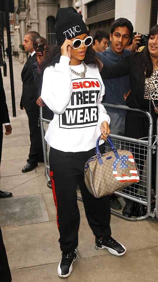 """What do you think the """"T.W.C."""" on Rihanna's silly stocking hat stands for? We're leaning towards """"train wreck central."""" Discuss!<br>(8/31/2012)<br><br><a target=""""_blank"""" href=""""http://omg.yahoo.com/news/rihanna-ex-boyfriend-chris-brown-kiss-vmas-175719471.html"""">Rihanna, ex Chris Brown kiss at VMAs</a>"""