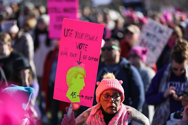 Protester bears the unofficial color of the 2018 Women's March in Charlotte, N.C. (Photo: Getty Images)