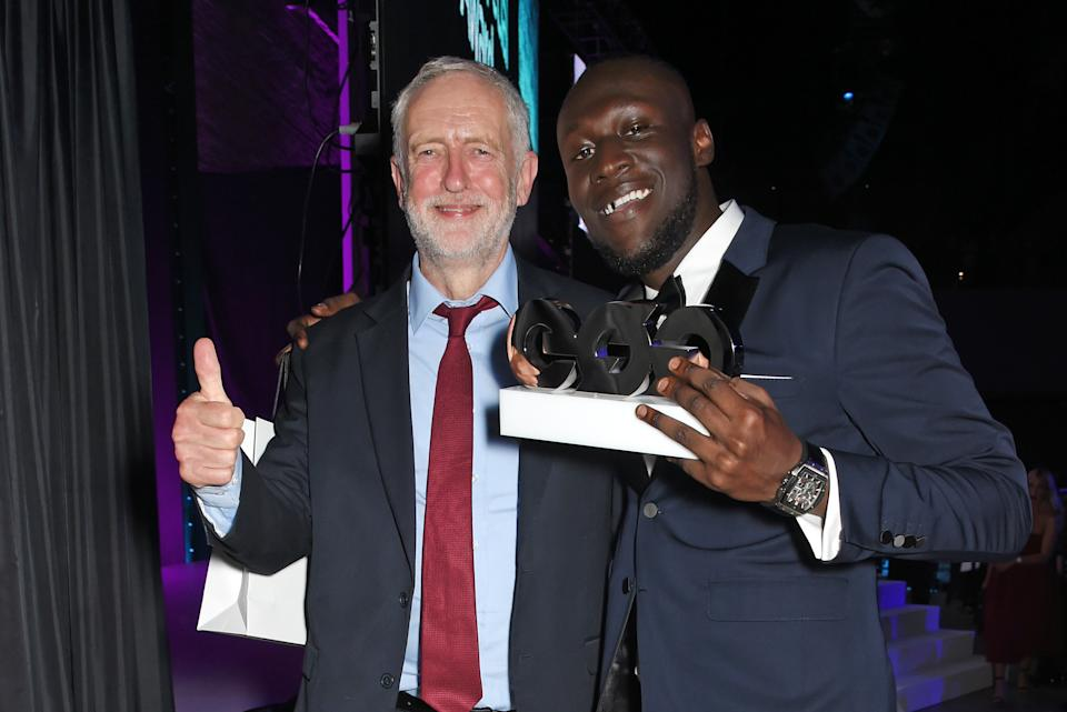 LONDON, ENGLAND - SEPTEMBER 05:  Leader of the Labour Party Jeremy Corbyn (L) and Stormzy, winner of the Solo Artist of the Year award, attend the GQ Men Of The Year Awards at the Tate Modern on September 5, 2017 in London, England.  (Photo by David M. Benett/Dave Benett/Getty Images)