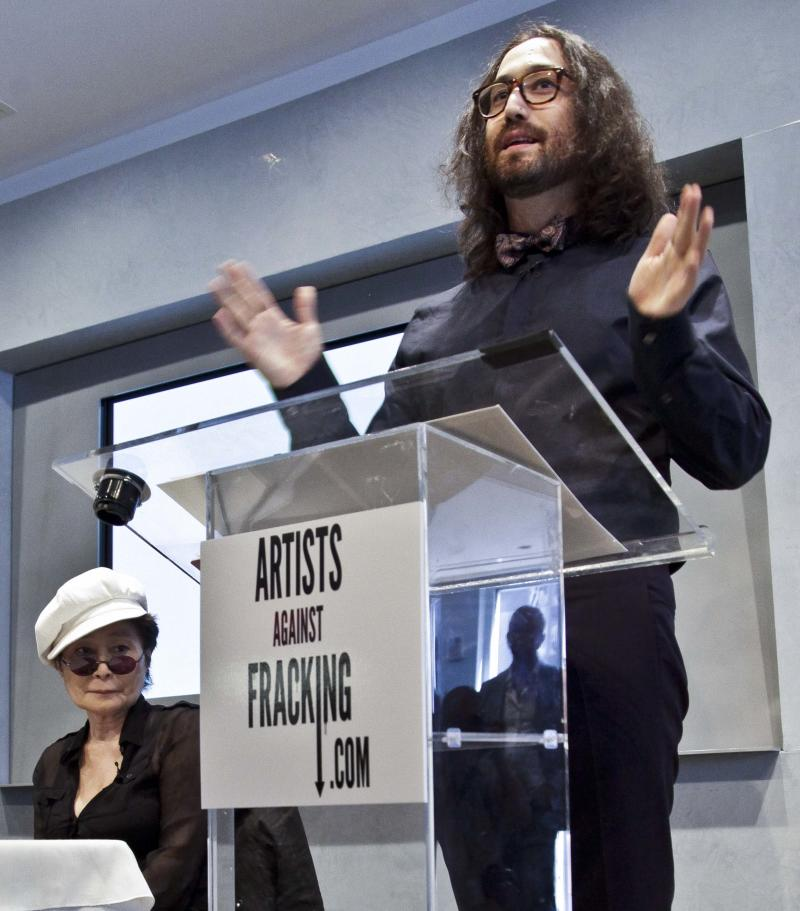 "Yoko Ono, left, listens as her son Sean Lennon speaks during a news conference to launch a coalition of artists opposing hydraulic fracturing on Wednesday, Aug. 29, 2012 in New York. The formation of the group, called Artists Against Fracking, comes as New York Gov. Andrew Cuomo decides whether to allow shale gas drilling using high-volume hydraulic fracturing called hydrofracking. The group says such drilling is harmful and poses the threat of contamination. They say they want to spread awareness of the issue through ""peaceful democratic action."" Cuomo is expected to allow drilling to begin on a limited basis near the Pennsylvania border. The group is comprised of 146 members including Lady Gaga, Paul McCartney and Alec Baldwin. (AP Photo/Bebeto Matthews)"