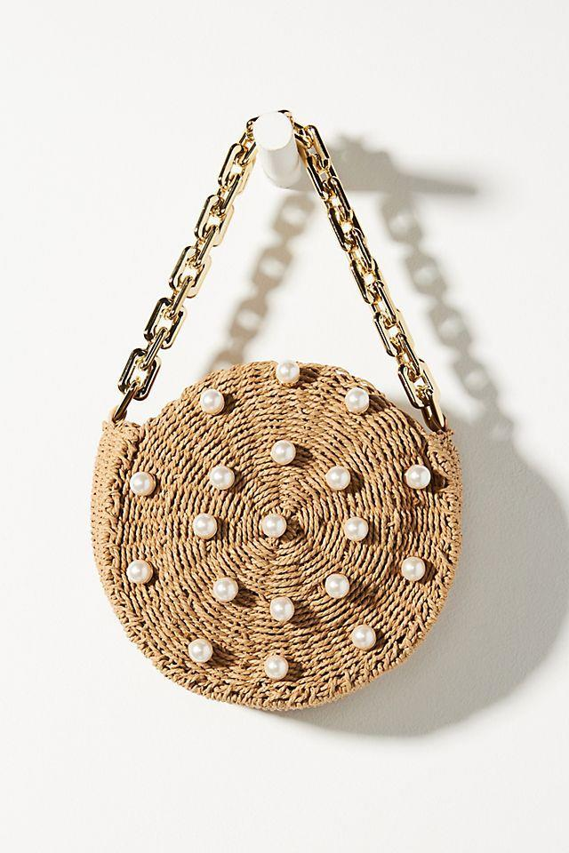 """<br><br><strong>btb Los Angeles</strong> Chain-Link Round Straw Clutch, $, available at <a href=""""https://go.skimresources.com/?id=30283X879131&url=https%3A%2F%2Fwww.anthropologie.com%2Fshop%2Fchain-link-round-straw-clutch"""" rel=""""nofollow noopener"""" target=""""_blank"""" data-ylk=""""slk:Anthropologie"""" class=""""link rapid-noclick-resp"""">Anthropologie</a>"""