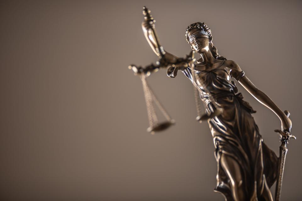 Statue of the lady of justice with scales close-up. (Photo: SimpleImages via Getty Images)