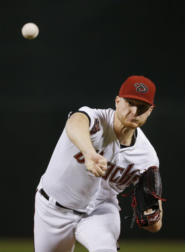 Arizona Diamondbacks starting pitcher Shelby Miller warms up during the first inning of a baseball game against the San Diego Padres Thursday, July 5, 2018, in Phoenix. (AP Photo/Ross D. Franklin)