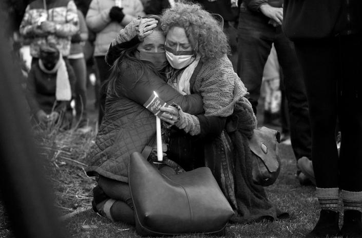 Mourners hug at a vigil for the victims of a mass shooting at a grocery store earlier in the week, outside the courthouse in Boulder, Colo. (David Zalubowski/AP)