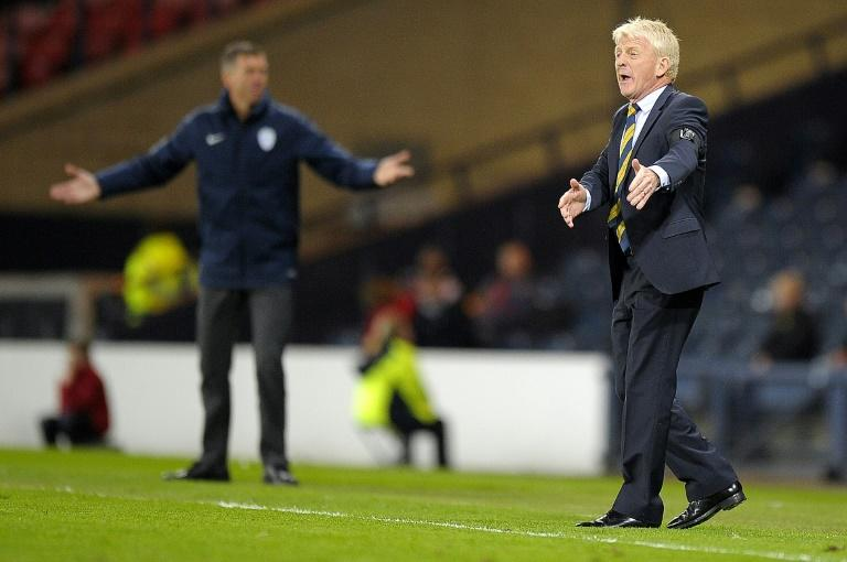 Scotland's manager Gordon Strachan (R) gestures on the touchline during the World Cup 2018 qualification football match against Slovenia March 26, 2017