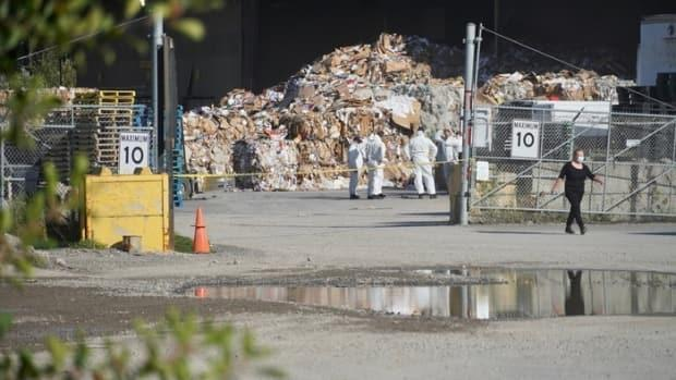 Ottawa police investigate at the Cascades Recovery recycling plant on Sheffield Road Friday afternoon.  (Emilien Juteau/Radio-Canada - image credit)