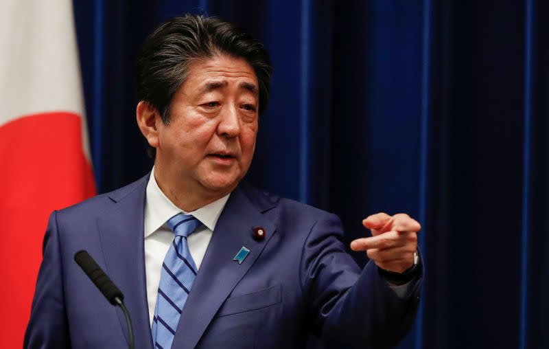 Japan's Prime Minister Shinzo Abe gestures as he speaks during a news conference on Japan's response to the coronavirus outbreak at his official residence in Tokyo