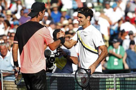 Mar 24, 2018; Key Biscayne, FL, USA; Thanasi Kokkinakis of Australia (L) shakes hands with Roger Federer of Switzerland (R) after their match on day five of the Miami Open at Tennis Center at Crandon Park. Kokkinakis won 3-6, 6-3, 7-6(4). Mandatory Credit: Geoff Burke-USA TODAY Sports