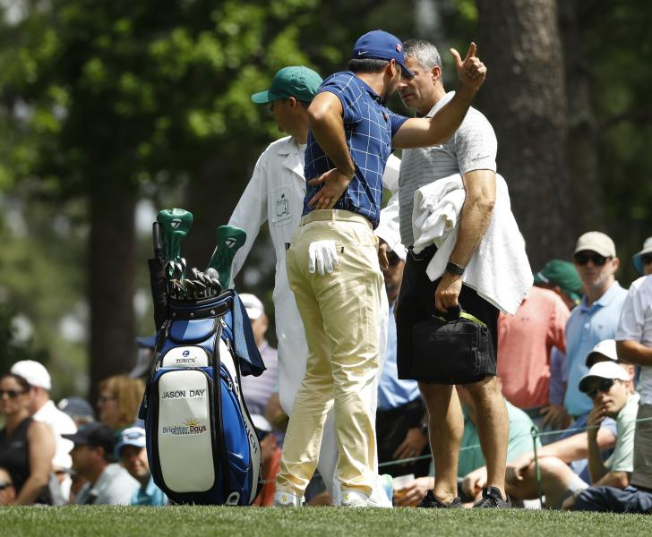 Jason Day, of Australia, holds his back on the fourth tee during the first round for the Masters golf tournament Thursday, April 11, 2019, in Augusta, Ga. (AP Photo/Matt Slocum)
