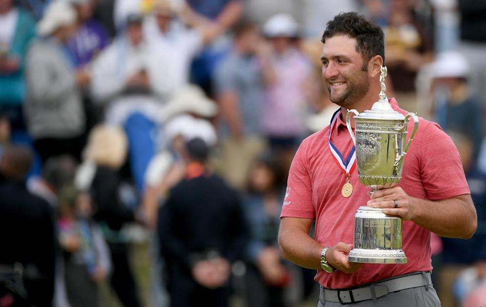 June 20: Jon Rahm celebrates with the trophy after winning the U.S. Open at Torrey Pines Golf Course.