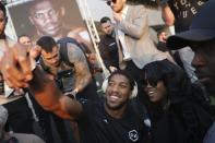 """Heavyweight boxer Anthony Joshua of Britain takes a selfie during a weigh-in at Faisaliah Center, in Riyadh, Saudi Arabia, Friday, Dec. 6, 2019. The first ever heavyweight title fight in the Middle East, has been called the """"Clash on the Dunes."""" Will take place at the Diriyah Arena on Saturday. (AP Photo/Hassan Ammar)"""