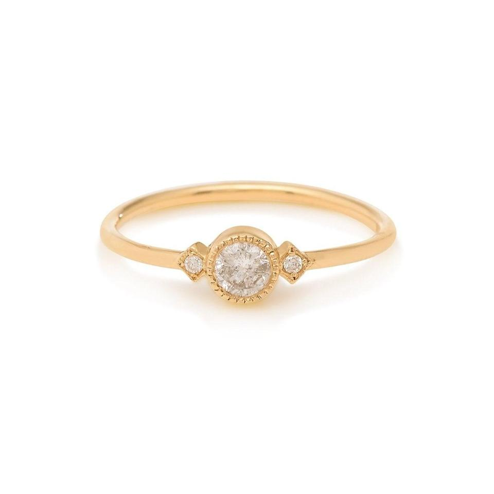"""<p>Although it looks white, the center diamond in the <a href=""""https://www.popsugar.com/buy/Gray-Diamond-Sotto-Voce-Ring-532219?p_name=Gray%20Diamond%20Sotto%20Voce%20Ring&retailer=stoneandstrand.com&pid=532219&price=635&evar1=fab%3Aus&evar9=7954958&evar98=https%3A%2F%2Fwww.popsugar.com%2Fphoto-gallery%2F7954958%2Fimage%2F47021267%2FGray-Diamond-Sotto-Voce-Ring&list1=shopping%2Cwedding%2Cjewelry%2Crings%2Cbride%2Cengagement%20rings%2Cfashion%20shopping&prop13=api&pdata=1"""" rel=""""nofollow noopener"""" class=""""link rapid-noclick-resp"""" target=""""_blank"""" data-ylk=""""slk:Gray Diamond Sotto Voce Ring"""">Gray Diamond Sotto Voce Ring</a> ($635) is actually gray.</p>"""