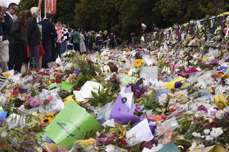 People look at tributes at the Botanic Gardens in Christchurch (AFP/Getty Images)