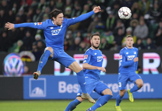 Hoffenheim's Nico Schulz, left, eyes a ball during the German Bundesliga soccer match between VfL Wolfsburg and 1899 Hoffenheim in Wolfsburg, northern Germany, Saturday, Dec. 8, 2018. (Peter Steffen/dpa via AP)