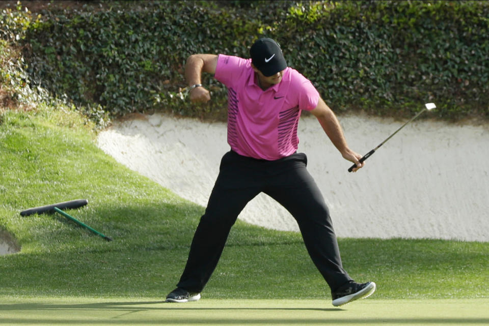 Patrick Reed reacts to his birdie on the 12th hole during the fourth round at the Masters. (AP)
