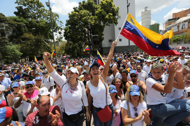 Anti-government protesters rally to demand the resignation of Venezuelan President Nicolas Maduro in Caracas, Venezuela, Monday, March 4, 2019. The United States and about 50 other countries recognize opposition Congress President Juan Guaido as the rightful president of Venezuela, while Maduro says he is the target of a U.S.-backed coup plot. (AP Photo/Fernando Llano)