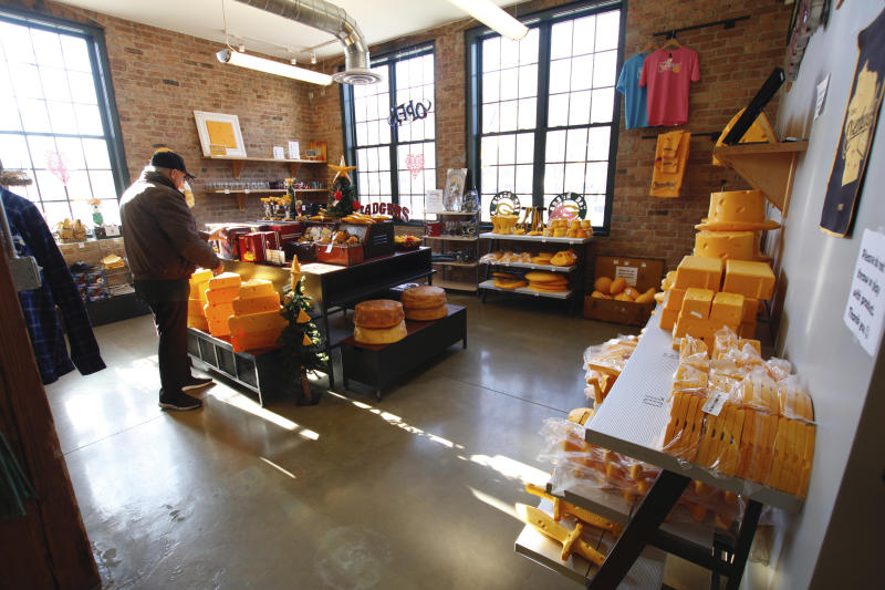 This Jan. 16, 2020 photo shows the store at Foamation, Inc. in Milwaukee. Ralph Bruno invented the yellow wedge cheesehead in 1987 from his mother's couch stuffing and it has since become popular, particularly for Wisconsin sports fans and residents. Foamation, Inc. moved into a new location in 2016 and soon started tours where people can make their own cheeseheads or other foam products.  (AP Photo/Carrie Antlfinger)