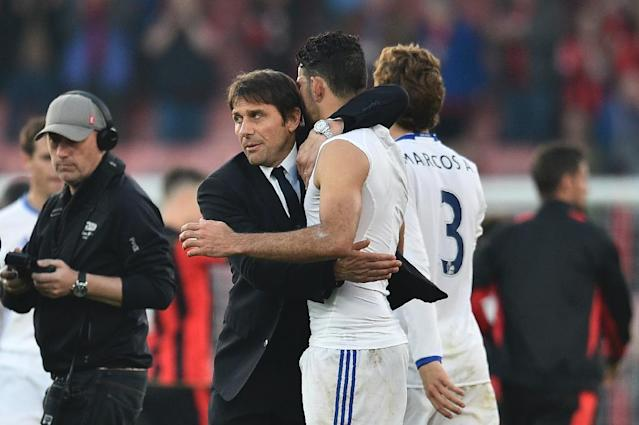 Chelsea's head coach Antonio Conte (L) embraces Chelsea's striker Diego Costa (R) at the end of the English Premier League football match between Bournemouth and Chelsea at the Vitality Stadium in Bournemouth, southern England on April 8, 2017 (AFP Photo/Glyn KIRK )
