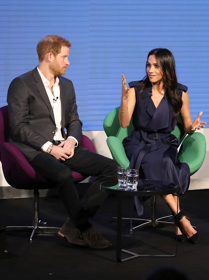 """<p>Meghan joined Prince Harry, Kate Middleton, and Prince William in February 2018 for the first annual Royal Foundation Forum in London. She styled a <a rel=""""nofollow"""" href=""""https://www.popsugar.com/fashion/Meghan-Markle-Jason-Wu-Trench-Dress-44623612"""">navy Jason Wu trench</a> with black Aquazzura heels for the occasion.</p>"""