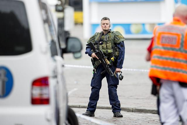 <p>An armed police officer stands guard at the Turku Market Square in the Finnish city of Turku where several people were stabbed on Aug. 18, 2017. (Roni Lehti/AFP/Getty Images) </p>