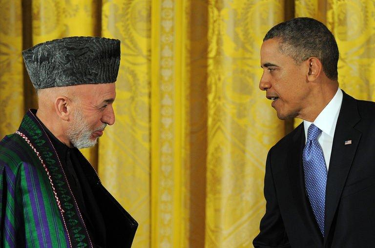 "US President Barack Obama and his Afghan counterpart Hamid Karzai leave after a joint press conference at the White House on January 11, 2013. Obama has said the US goal in Afghanistan was ""within reach"" as he vowed to move ahead with a timetable to end the 11-year-old military campaign and focus on a broad domestic agenda"