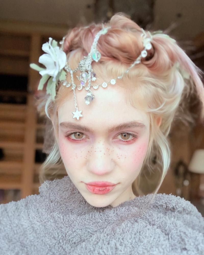Did Grimes Remove Part of Her Eyeball in an Experimental Surgery?