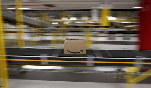 Boxes are moved on conveyor belts at Amazon distribution center in El Prat de Llobregat, near Barcelona, Spain, March 15, 2018. REUTERS/Albert Gea - RC152EB02760