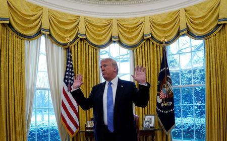 U.S. President Donald Trump speaks during an interview with Reuters at the White House in Washington, U.S., January 17, 2018. REUTERS/Kevin Lamarque