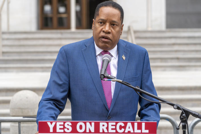 Conservative radio talk show host Larry Elder speaks to supporters during a campaign stop outside the Hall of Justice downtown Los Angeles, Thursday, Sept. 2, 2021. Elder is running to replace Democratic Gov. Gavin Newsom in the Sept. 14 recall election. The recall was largely driven by frustration with Newsom's sweeping coronavirus orders that closed schools, businesses and in turn, cost millions of jobs. In a television ad this week, Newsom's campaign blasted his Republican rivals as anti-vaxers, However Elder, and other top GOP candidates Kevin Faulconer, Kevin Kiley and John Cox all say they have been vaccinated against the virus and none has flatly said the vaccines are dangerous. (AP Photo/Damian Dovarganes)
