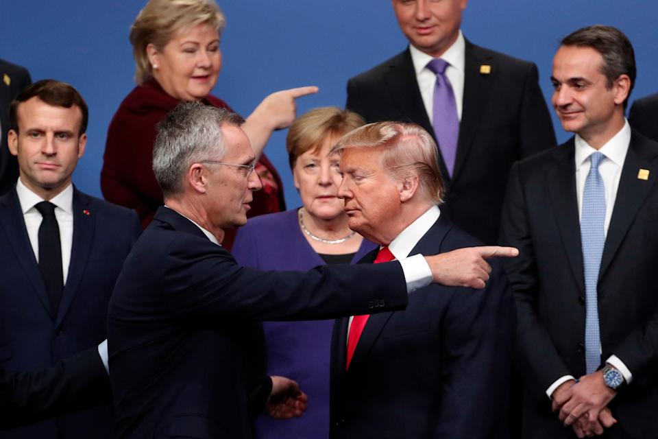 Which way next? NATO Secretary General Jens Stoltenberg, front left, speaks with U.S. President Donald Trump, front right, after a group photo at a NATO leaders meeting at The Grove hotel and resort in Watford, Hertfordshire, England in December 2019. (AP Photo/Francisco Seco, File) (AP)