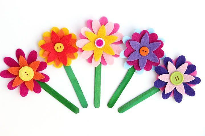 "<p>Moms who love to read will make great use out of these Felt Flower Bookmarks from Happiness is Homemade. Toddlers have plenty of opportunity to great creative while designing them, with the option to layer multi-colored petals, buttons and more.</p><p><em><a href=""https://www.happinessishomemade.net/felt-flower-bookmarks/"" rel=""nofollow noopener"" target=""_blank"" data-ylk=""slk:Get the tutorial."" class=""link rapid-noclick-resp"">Get the tutorial.</a></em></p>"