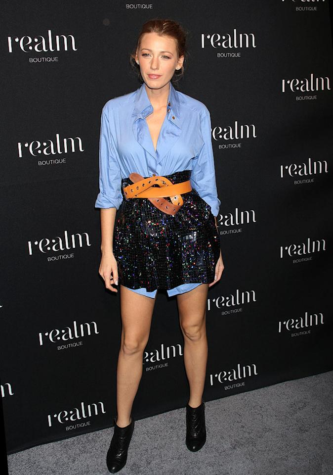 """Budding fashionista Blake Lively did herself a disservice by donning this oversized men's oxford, bizarrely belted sparkly diaper, and black booties to the recent Realm store opening in SoHo. <a href=""""http://www.splashnewsonline.com"""" target=""""new"""">Splash News</a> - November 5, 2010"""